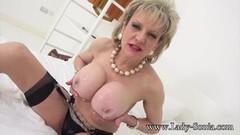 Naughty Lady Sonia lotions up her big plump tit Thumb