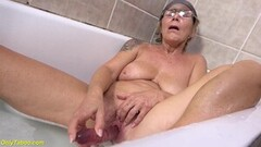 Horny Busty Grandma Pissing in The Bathtub Thumb